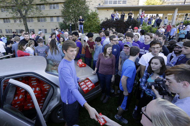 IMAGE DISTRIBUTED FOR THE HERSHEY COMPANY - Hunter Jobbins, freshman at Kansas State University, hands out nearly 6,500 Kit Kat bars on Thursday, Nov. 3, 2016, in Manhattan, Kansas. Earlier this week, Jobbins had a Kit Kat bar stolen from his unlocked car and a mysterious note was left from the thief. (Colin E. Braley/AP Images for The Hershey Company)